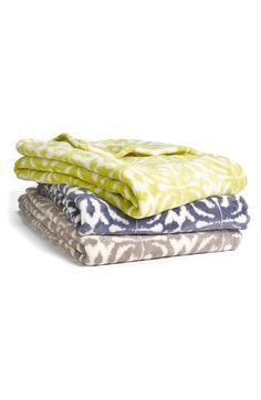 'Ikat Tile' Throws. Love the colors and pattern.