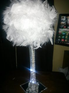 DIY Center Piece made with 5 inch styrofoam ball from Michaels, square mirror and 6 inch feather boa from King .99. trim vase with bling add water beads and lights. I stuck a dowl stick in middle of ball to keep it sturdy. Very Inexpensive and Cute