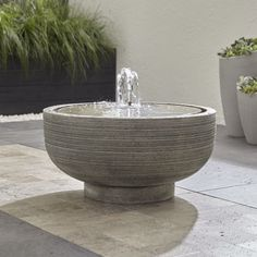 Shop Girona Cast Stone Fountain.  Classically simple with contemporary texture, this artisan-crafted, cast-stone fountain enlivens the garden or patio with the sparkle and soothing sound of flowing water.