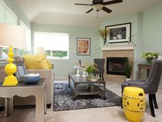 See how gray furniture with yellow accents can work with mint green walls to provide a serene sitting area at HGTV.