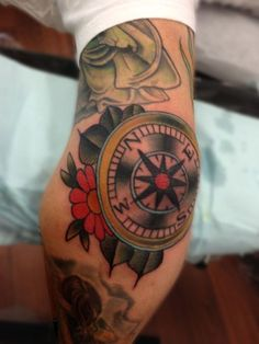 Old school compass with flowers tattoo