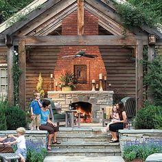 Love this outdoor fireplace + open beams w/arbor; mix of fieldstone + brick; steps; ceiling fan