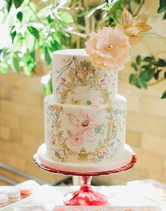 Seriously, this hand painted beauty is just adorable! Who wouldn't want this at their shower or wedding!?