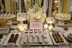 Love this wedding dessert table! White flowers compliment the sleek china on which miniature desserts are placed. Dessert Buffet Table, Candy Table, Candy Buffet, Mini Desserts, Wedding Desserts, Wedding Desert Table, Sweet Table Wedding, Buffet Table Wedding, Sweet Tables