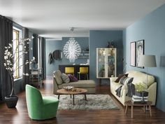 Coziness with character. Bring some brightness into your living room with colorful accent furniture and textiles.