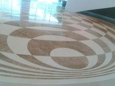A custom made 34' medallion for a Westin Hotel in Panama. The marble medallion (Paradise Polished in   Champagne) was fabricated here in the US and shipped to Panama. http://www.marblesystems.com/products/collection/paradise-polished/ #marble #stone #design #entry #foyer #medallion