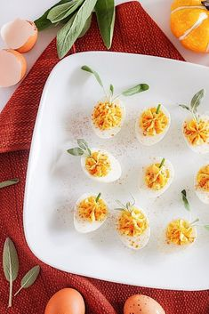 Celebrate World Egg Day on October 9th with adorable pumpkin patch deviled eggs! #WorldEggDay #sponsored #deviledeggs Fall Appetizers, How To Make Pumpkin, Little Pumpkin, Deviled Eggs, Fresh Lemon Juice, Pumpkin Puree, Fresh Herbs, Hot Sauce, Cheddar Cheese