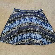 Rue 21 Skirt Blue, black, white and red. Very soft material. Stretchy waistband. Size L/XL. Length 18.5 inches (top of waistband to bottom of skirt). Gently used. Rue 21 Skirts Midi