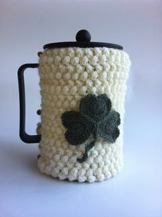 Hand Made Crochet Coffee Cosy, bobble stitch, with deep green Shamrock detail, buttons to close. Will fit Bodem height lenght Etsy Ireland Team. Bobble Stitch, Coffee Cozy, Stay Warm, Celtic, Knit Crochet, Great Gifts, Crafty, Cream, Knitting