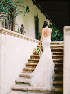 Stunning backless wedding dress captured fine art wedding photographer Milton Photography