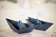 Possible place cards, the reception is at a rowing and sailing center.