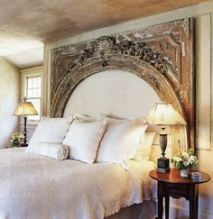 headboard from a fireplace surround...going to check architectural salvage shops or this one...or find an old door/ archway