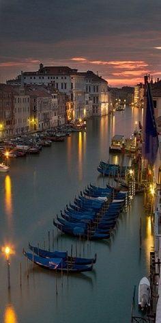 Gondolas in the Gran Canal, dusk, Venice, Italy.