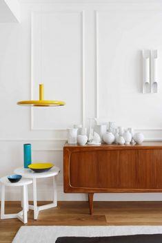 display of all white ceramics on a danish modern piece