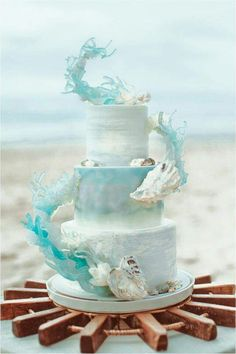 One of the most unique and artistic beach theme wedding cakes I've seen in a while (coming from a beach destination wedding stationery designer, I've seen a lot. Pretty Cakes, Beautiful Cakes, Amazing Cakes, Beautiful Beach, Ocean Cakes, Beach Cakes, Beach Theme Cakes, Crazy Cakes, Fancy Cakes
