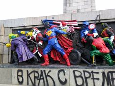 Art in the Streets of Sofia-Soviet Army monument , Bulgaria1 Close up of the re-done war monument.  Vintage Russian soldiers recast as super-heroes.