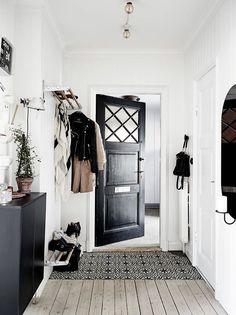 black and white organized entryway