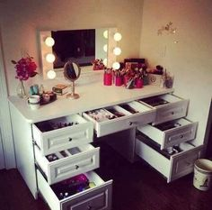 love this vanity table =] with lots of drawers = great organization. Just need a bigger 3 way mirror to complete it