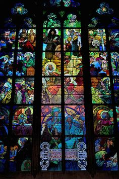 Stained glass window in St. Vitus Cathedral in Prague that was designed by Czech Art Nouveau master, Alphonse Mucha.