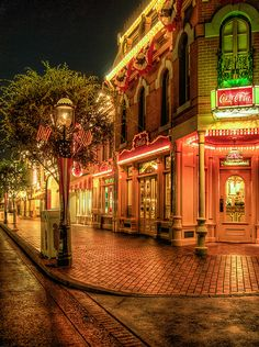 I remember seeing exactly this one night, when we had special tickets to stay in the park 2 hours after closing...  Ted and I were one of the last ones to amble out, we took our sweet time, and enjoyed the total quiet of Main Street.  Had a bit of an idea how Walt Disney himself felt in the park when no one else was around.  :)  Very special, very magical.  Worth every penny of that special ticket.  :)