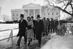President-elect John F. Kennedy, his wife Jackie and others walking to JFK's inauguration, January 1961