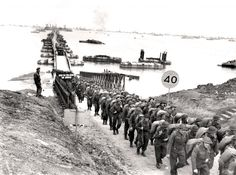 Canadian troops land at Arromanches, France, July 1944. HAROLD G. AIKMAN, LIBRARY AND ARCHIVES CANADA—PA116514