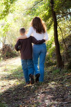 Mother and son walking down path together arm in arm.  Could be a good idea for a Mother's Day photo.
