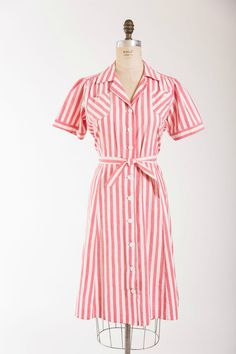 Vintage 1940s dress made of a cotton with red chambray stripes. Fitted waist, puffed short sleeves, gathers at the shoulders to add blousons to