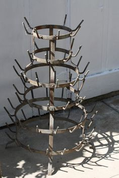 "I'd make a bottle tree...  French Bottle Drying Rack Model FBD9   $494  SOLD  Love these antique drying racks to hold ribbon spools or your favorite tea cup collection. (We have one that stands almost five feet holding our collection of ribbons used in the boutique! We're constantly asked but we'll never sell!) Originally used for drying bottles holding liqueu, sodas and the like. This one is zinc metal with 2 prongs missing, otherwise in fantastic condition. 27 H x 19"" W. Five rows of…"
