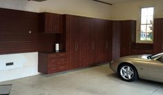 A job well done by Tailored Living Cincinnati on this Mahogany Melamine #garage cabinet installation!