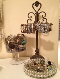 How I displayed my jewelry... If you're a jewelry fanatic like myself then its hard to remember what all you have... So I used a toilet paper holder (i know..lol) for the bracelets I wear most.. the others in a bowl... and my rings are on a mirrored tray! PERFECT! Now you can see all your options! (All these items are from hobby lobby) :)