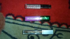 Various brands of Lip Gloss(Colours from top to bottom: Nude, Purple and Gold)