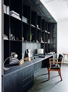 House tour: a spacious 19th-century apartment gets a cool Nordic makeover: Customshelves by Bundgaard Rützou create an office space at the end of the living room.