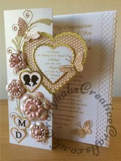 Dimensional A4 Wedding Card made using a variety of dies including; Cheery Lynn Nesting Heart to heart doily dies, Spellbinders nesting scalloped and plain hearts, Tattered Lace Lavish Blooms Poppies and lacy rose dies, Quickutz cookie cutter man silhouette, quickutz 2″x2″ cameo die for female silhouette (die cuts heat embossed with clear embossing powder), Spellbinders Sapphire Font one for monograms (then heat embossed with clear embossing powder), Memory box Gwyneth flourish die and…