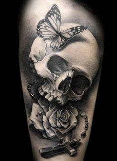 Skull tattoo on upper arm