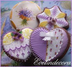 Exquisite lavender & gold piping with gumpaste and hand-painted violets on Valentine's Day cookies. Beautifully crafted by Evelindecora and posted on Cookie Connection.
