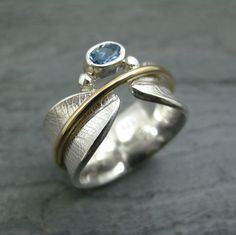 Argentium silver band with roller-milled Bodhi leaf texture, 14/20 yg-filled spinner and aquamarine.