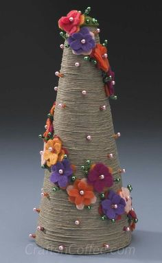 Patty Schaffer has done it again – she's sharing another must-have springtime topiary to DIY. Her Divine Twine Topiary pairs rustic twine with bold felt flowers and sparkling beads for a stunning c.DIY jute twine topiary tutorial by Patty Schaffe Christmas Tree Forest, Christmas Tree Crafts, Felt Christmas, Xmas Tree, Christmas Projects, Holiday Crafts, Christmas Decorations, Christmas Ornaments, Christmas Time