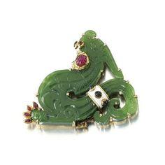 Enamel, nephrite, ruby and sapphire 'Dragon' pendant/brooch, David Webb. photo Sotheby's
