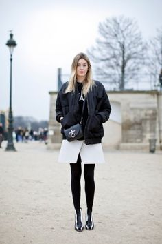 little cross-body bag with stark white skirt, printed black sweatshirt (!), and the kind of jacket my grandpa would wear