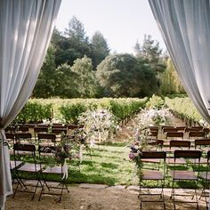 Does it get any better than this ceremony setting at a private estate in Saint Helena? We love this shot by @sylviegil. Floral design by @nataliebdesigns #amynicholsspecialevents