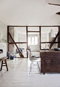 open framed apartment/loft, white painted floorboards, eames chair, exposed timber