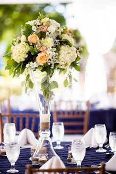 Navy wedding at Inn on Peaks. Accents of peach and Corals.