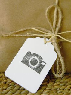 Camera Hand stamped tags, when giving clients their pictures wrap em up nice! better then jut handing them a CD or folder.
