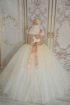 This amazing flower girl dress is a vintage inspired tutu dress with a champagne crochet top and ivory and champagne tulle skirt, adorned