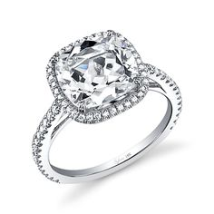Style# SY395 Unique Cushion Cut Halo Diamond Engagement Ring - This magnificent white gold engagement ring features a unique and dazzling 1.5 carat cushion cut diamond center accentuated by a shimmering halo of round brilliant diamonds. Cascading diamonds down the shank create a flow of breathtaking sparkle as it holds the glorious crown. https://www.sylviecollection.com/unique-cushion-cut-halo-diamond-engagement-ring-sy395