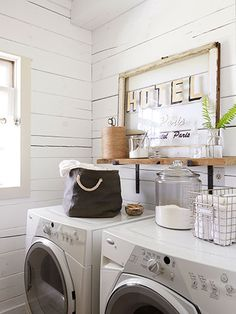 A vintage hotel sign, along with glass canisters for detergent and such, prettifies the laundry room.