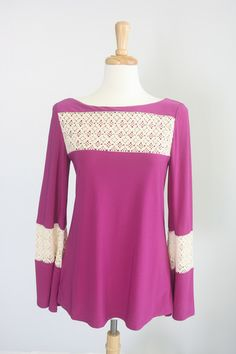 Missy Robertson's new clothing line!  Love it!  Fuchsia Knit Top with Crochet Inset.  $89