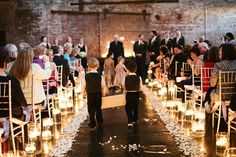 Lighting the aisle with glass candle holders makes it look magical. Great idea.