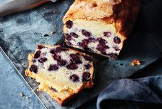 Here's a dangerous thing to know: If you've got yogurt, eggs, and frozen blueberries, you can transform them into a lemon-scented loaf cake with just a few pantry ingredients. No need to cream butter and sugar or do anything complicated, just whisk, stir, and wait until your kitchen is bathed in scent of baking pound cake. Don't skip tossing the blueberries with flour. This helps them stay aloft while the batter bakes, so that you get a juicy blueberry in each bite.
